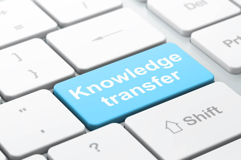 Education concept: Knowledge Transfer on keyboard background